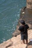 Fisherman, Tanah Lot, Bali, Indonesia Royalty Free Stock Image
