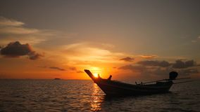 Fisherman Thai Wooden Sail Boat Silhouette Floating on Sea Horizon. Amazing Colors of Tropical Sunset. HD Slowmotion stock video footage
