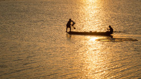 Fisherman Thailand. In action when fishing in the lake Time sundown Royalty Free Stock Photo
