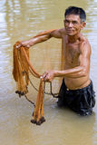 Fisherman of Thailand with throw net. In the water with the fishing Stock Photos