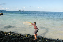 Fisherman throwing a fishing net into the sea Royalty Free Stock Photos