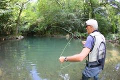 Fisherman throwing hook Royalty Free Stock Photo