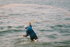 Fisherman throwing a net in India Kerala Stock Photos