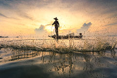 Fisherman throwing net royalty free stock image
