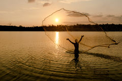 Fisherman throwing Royalty Free Stock Photography