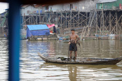 Fisherman in Tonle Sap, Cambodia stock images