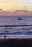Fisherman and Trawler at Dusk on the Gulf of Mexico Royalty Free Stock Photography