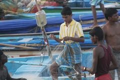 Fisherman untangle net in Kanyakumari Royalty Free Stock Images