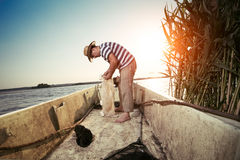 Fisherman untangling the net Royalty Free Stock Images