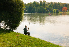 Fisherman on the Upper Tsaritsyno pond Stock Photo