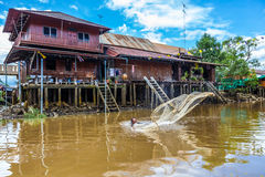 The fisherman use the fish net to catch the fish Stock Photo