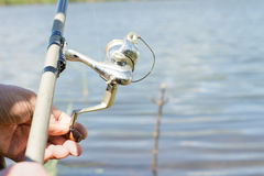 Fisherman using a spinning reel Stock Photos