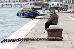 Fisherman in Venice Stock Photo