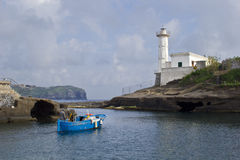 Fisherman in ventotene. Harbor and lighthouse royalty free stock images