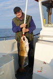 Fisherman with very big fish. On the boat Royalty Free Stock Photo
