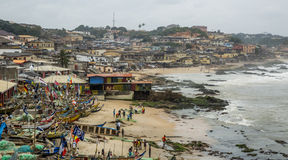 Fisherman village in Ghana. Cape Coast, Ghana - July 31, 2014: Fisherman village in Ghana, near to the Cape Coast. Traditional Ghanian fisherman boats parked at Royalty Free Stock Image