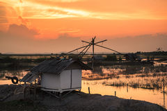 Fisherman village with giant fish net at sunset.  Royalty Free Stock Image
