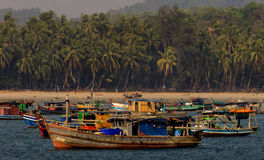A fisherman village near Ngpali in Burma (Myanmar). Boats on a beach of a Burmese fishing village on the West coast of Myanmar. On March 2016 it was elected the stock photography