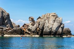 The fisherman village placed on the big rock, Moo Koh Chumphon, Chumohon province, Thailand. Bird's Nest Collectors' Bungalows p Stock Photography
