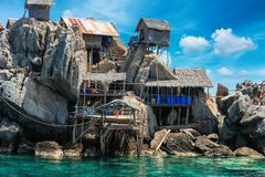 The fisherman village placed on the big rock, Moo Koh Chumphon, Chumohon province, Thailand. Bird's Nest Collectors' Bungalows p. The fisherman village placed on Stock Photo