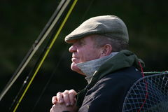 Fisherman waiting. By the river with rods Stock Photography