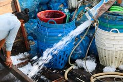 Fisherman waiting for unloading ice for frozen fish on the fishi stock photos
