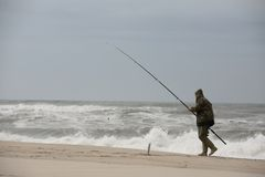 Fisherman walking Royalty Free Stock Images