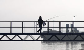 Fisherman walking Royalty Free Stock Photos
