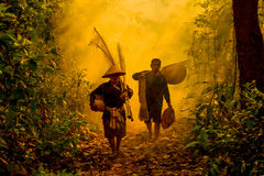 Fisherman Walking. In the forest Go to river Royalty Free Stock Photography