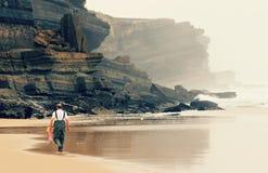 Fisherman Walks on Beach Royalty Free Stock Image