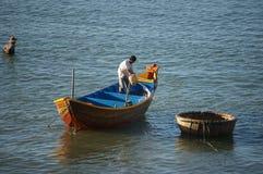 Fisherman wash the boat Stock Photo