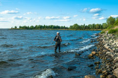 Fisherman in water Stock Photography
