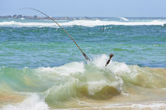 Fisherman in wave Royalty Free Stock Photo