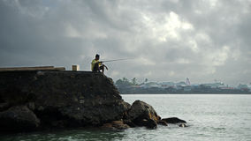 Fisherman on a wharf Royalty Free Stock Photography