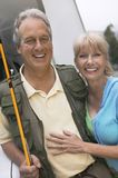 Fisherman with wife outdoors (portrait) Stock Photos