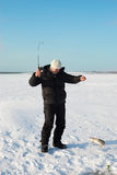 The fisherman on winter fishing stock photo