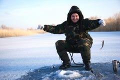Fisherman on winter lake stock image