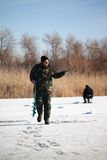 Fisherman on winter lake Stock Images