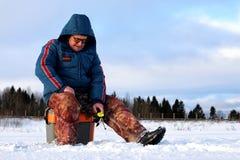 Fisherman Winter on the Lake Royalty Free Stock Photos
