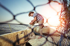 Fisherman at work, cleaning the nets Stock Photography