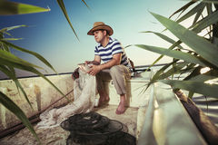 Fisherman at work, cleaning the nets Royalty Free Stock Photo