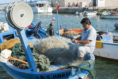 Fisherman at work Stock Images