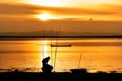 Fisherman work in sunset Stock Photo