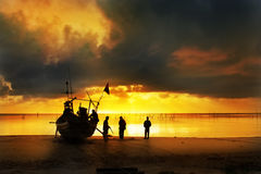 Fisherman work in sunset Royalty Free Stock Photo