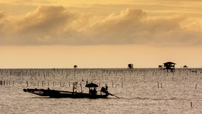 Fisherman work on twilight time Royalty Free Stock Photo