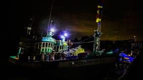 Fisherman working in fishing boat stock video
