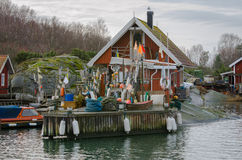 Fishermans łódź z molem i boathouse Obrazy Royalty Free
