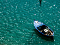 Fishermans boat. Blue boat in the turquoise see Stock Photography
