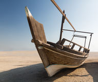 Fishermans boat or dhow on sand. Fishing or fisherman boat or dhow  in desert with no sign of the ocean in Bahrain, Middle East Stock Photography