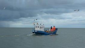Fishermans boat  in  sea bay stock footage